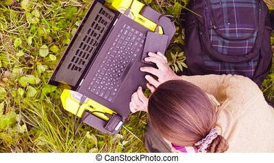 Woman scientist ecologist working on a laptop in the forest