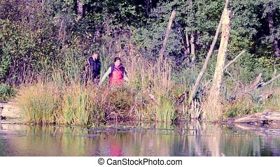 Two scientists ecologists in wild forest on the river bank -...