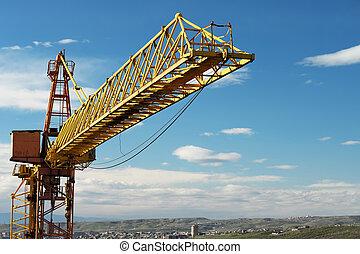 Crane tower against a blue sky