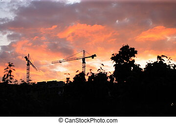 Crane Tower on Sunset Sky Background