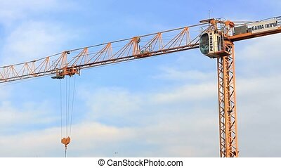 Crane turning around.  - Hoisting tower crane arm