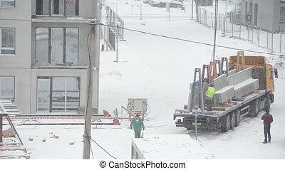 crane worker snow fall