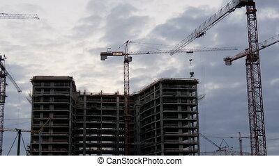 Crane working in big construction site