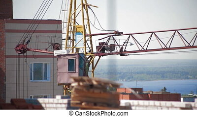 Crane working in construction site. Building house