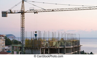crane working in construction site day to night time lapse