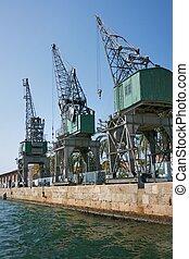 Cranes against blue sky