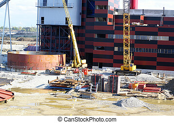 cranes and chinmey on construction of industrial factory