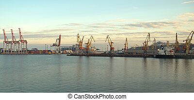 Cranes and containers at a port in the late afternoon period