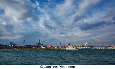 Cranes and port, marina entrance timelapse - Clouds over...