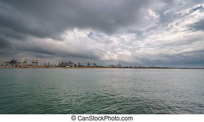 Cranes and port with water timelapse - Clouds over...