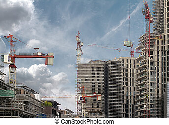 cranes at work in a construction site