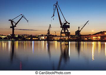 Cranes in Gothenburg at sunset. Gothenburg, Vasstergotland and Bohuslan, Sweden.
