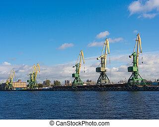 in the port of Sankt-Peterburg - cranes in the port of Sankt...