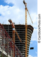 cranes on building construction site