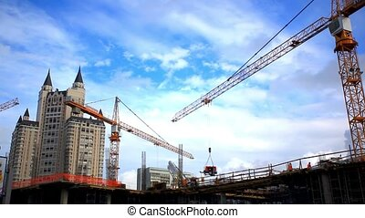 Cranes on the building in construction site. HD. 1920x1080