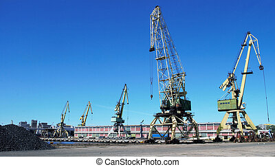Cranes on the keys in the port with blue sky