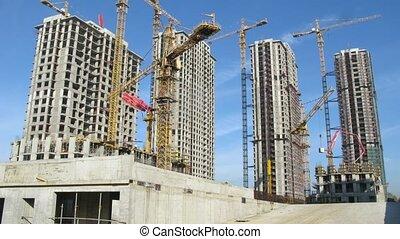 Cranes operate in front of Losiniy Ostrov estate