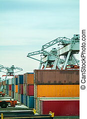 Cranes with containers in a harbor