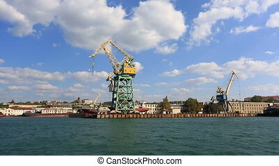 cranes working in the port of Sevastopol, a view from the...