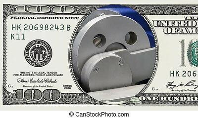 Crank drive gear wheel in frame of 100 dollar bill