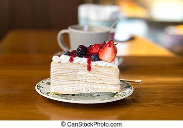 Crape cake with strawberry jam and cherry fruit on dish