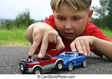 Crash - A boy playing with toy cars