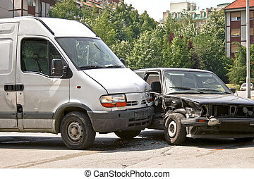 Traffic accident of mini van and car