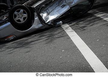 Crash - An upside-down car on a city street after a...