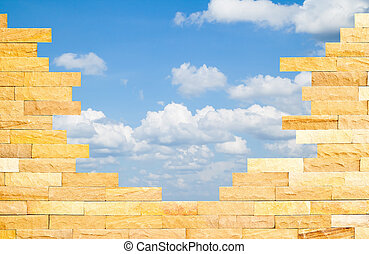 Crashed Brick Wall with beautiful blue sky behind