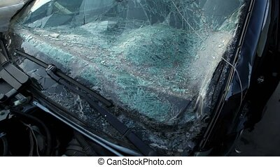 Crashed glass of car front window, closeup view in motion