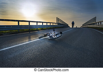 crashing bicycle accident in sunset light
