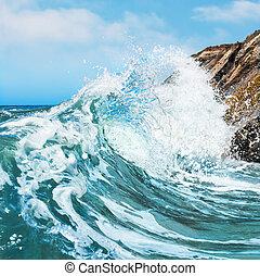 Crashing Wave - A wave crashing on the rocky shore at ...