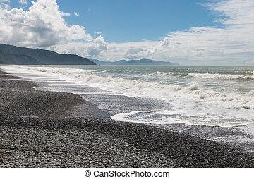 Rarangi beach in South Island, New Zealand - crashing waves...