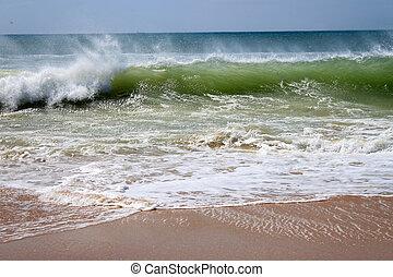 Crashing waves on the beach shore