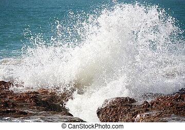 Crashing Waves - Waves crashing on a rock at the beach