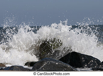 Waves crashing on the rock along the Delaware Bay