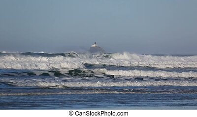 Crashing waves with decommissioned Tillamook Lighthouse...