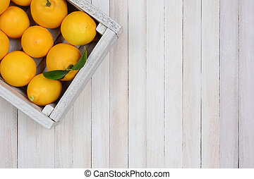 Crate of Lemons - A crate of fresh picked lemons on a rustic...