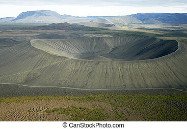 Deep crater seen from helicopter with other craters in the back. Myvatn area in Iceland