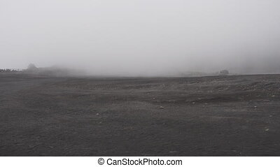 Crater of the Irazu volcano with mist in Costa Rica - Top of...