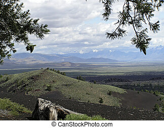 Craters of the Moon national Park, Idaho. A sea of lava flows with scattered islands of cinder cones ,sagebrush, spatter cones, lava tubes.