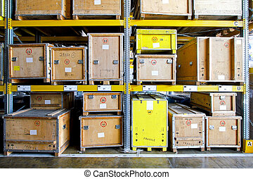 Wooden crates at shelves in museum warehouse