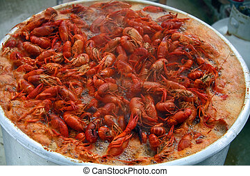 Crawfish in a pot of boiling spicy water.