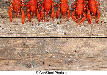 Crawfish on the old wooden background. Top view.