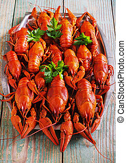 crawfish on wooden background in a plate