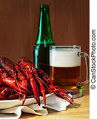 crawfishes and beer - red boiled crawfishes and mug of beer