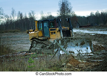 Crawler bulldozer on the construction of the highway