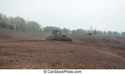 crawler tractor harrow - Crawler catterpillar heavy tractor...