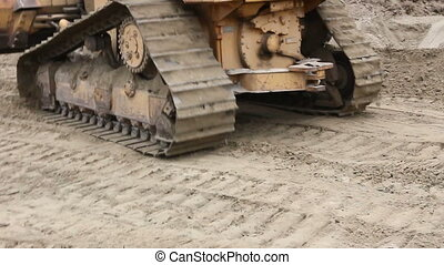 Crawler's tracks, bulldozer machine is leveling construction...