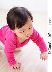 crawling baby girl on living room floor